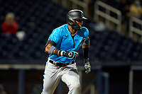 Miami Marlins Lewin Díaz (68) runs to first base during a Major League Spring Training game against the Washington Nationals on March 20, 2021 at FITTEAM Ballpark of the Palm Beaches in Palm Beach, Florida.  (Mike Janes/Four Seam Images)