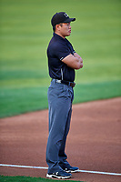 3B Umpire Shin Koishizawa handles the calls on the bases during the game between the Ogden Raptors and the Grand Junction Rockies at Lindquist Field on September 9, 2019 in Ogden, Utah. (Stephen Smith/Four Seam Images)