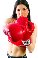 Beautiful brunette wearing red boxing gloves.