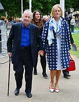 Sir Terence Conran, Lady Victoria Conran<br /> Michael Winner public memorial at the National Police Memorial that the film director & food critic helped establish, following his death on January 23rd. The Mall, London, England.<br /> June 23rd, 2013<br /> full length black suit blue shirt check jacket coat dress scarf holding hands cane<br /> CAP/BF<br /> ©Bob Fidgeon/Capital Pictures