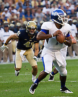 Pitt defensive back Andrew Taglianetti (41) closes in on Bulls quarterback Chazz Anderson (7). The Pittsburgh Panthers beat the Buffalo Bulls 35-16 at Heinz field in Pittsburgh, Pennsylvania on September 3, 2011
