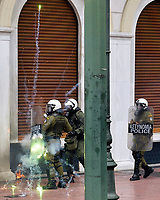 Pictured: A flare goes off by riot police officers Wednesday 17 May 2017<br /> Re: Clashes between anti fourth memorandum protesters and riot police during 24 hour strike in Athens, Greece