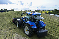 Germany, Biogas plant / DEUTSCHLAND, Damnatz im Wendland, Hof und Biogasanlage von Horst Seide, New Holland Traktor mit Dieselantrieb schiebt Maissilage