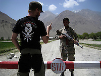 day 5, at our first check point jeremy tells the police officer how this is going to go down, the police officer lets us pass. What do war correspondences do on the holidays. 4 Kabul based journalists were the first westerners to ride motorcycles into the Wakhan corridor.the 12 day trip was full with dramas, breakdowns, arrests, crashes, yak riding and many miles. over 1200 kms they travelled and reached their desired destination of surhad e brogil deep in the wakhan corridor. location of the great game and once named the roof of the world.