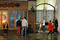 Pictured: A queue for the cash point next to a doorway with two couples. Sunday 31 December 2017 and 01 January 2018<br /> Re: New Year revellers in Wind Street, Swansea, Wales, UK