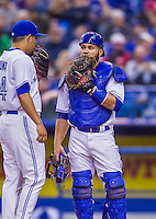 4 April 2015: Toronto Blue Jays catcher Russell Martin chats with his pitcher during game action against the Cincinnati Reds at Olympic Stadium in Montreal, Quebec, Canada. The Blue Jays defeated the Reds 9-1 in the second of two MLB weekend exhibition games. The series marked the first time since 2004 that the Reds played at Olympic Stadium, during the last season of the Montreal Expos. Mandatory Credit: Ed Wolfstein Photo *** RAW (NEF) Image File Available ***