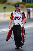 May 19, 2012; Topeka, KS, USA: NHRA funny car driver Mike Neff during qualifying for the Summer Nationals at Heartland Park Topeka. Mandatory Credit: Mark J. Rebilas-
