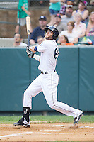 Taylor Zeutenhorst (60) of the Pulaski Mariners follows through on his swing against the Burlington Royals at Calfee Park on June 20, 2014 in Pulaski, Virginia.  The Mariners defeated the Royals 6-4. (Brian Westerholt/Four Seam Images)