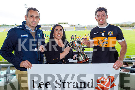 Austin Stacks captain Ronan Shanahan accepts the Roddy O'Donnell Memorial Cup from John Rice, Chairman of the Tralee Town Board and Theresa Walker of their sponsor Lee Strand after defeating John Mitchels in the final