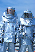 firefighters in heat resistant suits