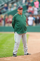 Fort Wayne TinCaps pitching coach Burt Hooton (26) watches his starting pitcher warm up in the bullpen prior to the game against the Lansing Lugnuts at Cooley Law School Stadium on June 5, 2013 in Lansing, Michigan.  The TinCaps defeated the Lugnuts 8-5.  (Brian Westerholt/Four Seam Images)