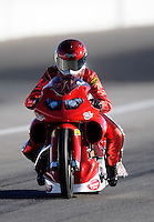Sept. 4, 2010; Clermont, IN, USA; NHRA pro stock motorcycle rider Angie Smith during qualifying for the U.S. Nationals at O'Reilly Raceway Park at Indianapolis. Mandatory Credit: Mark J. Rebilas-