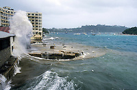 Violent waves crash against buildings in Port Vila Bay during Cyclone Beni, Efate Island, Vanuatu.
