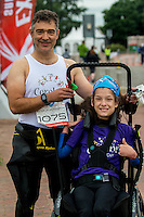 COPY BY TOM BEDFORD<br /> Sunday 26 June 2016<br /> Pictured: Poppy Jones and dad Rob before the race<br /> Re: A very special father-and-daughter team have tackled the Cardiff Triathlon.<br /> Poppy Jones, 11, who will be competing alongside dad Rob Jones, wants to win the event.<br /> And she's not going to let the fact that she has quadriplegic cerebral palsy , which means she can't sit, stand, roll or support herself, and chronic lung disease stop her.<br /> She will be by Rob's side every step of the way thanks to a cutting-edge wheelchair and boat – for Rob to push or pull – designed especially for the event, which sees participants take part in a swim across Cardiff Bay , a run and a bike ride.