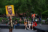 New York New York<br /> June 6, 2020<br /> Washington Square Park<br /> <br /> Demonstrators in Washington Square Park protest the racist aggressive attacks by the police against African Americans and other ethnic Americans. The protests were held world wide after 46 year old George Floyd was killed needlessly by police in Minneapolis, Minnesota on May 25, 2020.