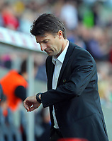 Saturday, 20 October 2012<br /> Pictured: A nervous Swansea manager Michael Laudrup checks the time on his watch during the last four minutes stoppage time.<br /> Re: Barclays Premier League, Swansea City FC v Wigan Athletic at the Liberty Stadium, south Wales.