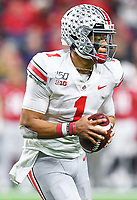 Indianapolis, IN - DEC 7, 2019: Ohio State Buckeyes quarterback Justin Fields (1) escapes the pocket for a first down during Big Ten Championship game between Wisconsin and Ohio State at Lucas Oil Stadium in Indianapolis, IN. Ohio State came back from a 21-7 deficit at halftime to beat Wisconsin 34-21 to win its third straight Big Ten Championship. (Photo by Phillip Peters/Media Images International)