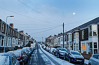 "Pictured: The lunar phonomenon known as Black Moon is seen over snow covered houses in Rhondda Street in the Mount Pleasant area of Swansea, caused by the ""Beast from the East"", south Wales, UK. Wednesday 28 February 2018<br /> Re: Strong cold winds from the east have been affecting most parts of the UK with temperatures in some parts below zero."