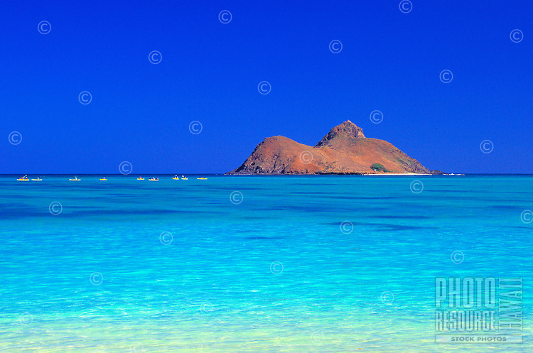 Kayakers paddle the turquoise waters of Lanikai beach
