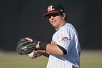 Catcher Andrew Walker (36) of the Hickory Crawdads warms up in the outfield at L.P. Frans Stadium in Hickory, NC, Wednesday, May 21, 2008.