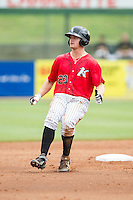 Adam Engel (23) of the Kannapolis Intimidators rounds second base during the game against the West Virginia Power at CMC-Northeast Stadium on April 30, 2014 in Kannapolis, North Carolina.  The Intimidators defeated the Power 2-1 in game one of a double-header.  (Brian Westerholt/Four Seam Images)