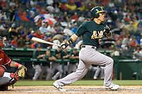 Oakland Athletics designated hitter Hideki Matsui (55) follows through on his swing against the Texas Rangers in American League baseball on May 11, 2011 at the Rangers Ballpark in Arlington, Texas. (Photo by Andrew Woolley / Four Seam Images)