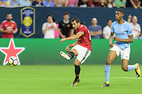 Houston, TX - Thursday July 20, 2017: Henrikh Mkhitaryan and Tosin Adarabioyo during a match between Manchester United and Manchester City in the 2017 International Champions Cup at NRG Stadium.