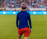 CHARLOTTE, NC - OCTOBER 3: Megan Rapinoe #15 of the United States warms up during a game between Korea Republic and USWNT at Bank of America Stadium on October 3, 2019 in Charlotte, North Carolina.