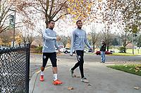 TUKWILA, WA - NOVEMBER 08: Jordy Delem #21 and Saad Abdul-Salaam #12 of the Seattle Sounders FC walk to training at Starfire Sports Complex on November 08, 2019 in Tukwila, Washington.