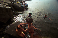 Families take a dip in the polluted waters of Manila Bay by Rizal Park, the largest park in Manila, Philippines named after national hero Jose Rizal. 17 November 2002