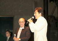 Actor & film maker Jackie Chan (R)  get on stage with World Film Festival's President  Serge Losique (L) for the free outdoor  projection of one of Chan's movie `. at the 25th World Film Festival,Sept 1st 2001 in Montreal, CANADA.<br /> <br /> Apprenticed to the Peking Opera by his parents at the age of 6, Jackie Chan was rigorously trained in music, dance, and traditional martial arts. A visiting filmmaker offered Chan his first (tiny) role as a stunt player. Chan took the part, and soon left the Opera to pursue the world of film. Fellow Opera students Biao Yuen and Sammo Hung Kam-Bo would also have careers in film, and the three would star in several films together in the following years. Chan's talent and enthusiasm soon saw him taking larger and more important roles, graduating first to stunt coordinator, and then to director. <br /> <br /> <br /> <br /> Following the death of martial arts legend Bruce Lee, the search was on for an actor who could inspire audiences to the same degree; every young martial artist was given a chance. Chan decided that rather than emulating Lee (and thus living forever in his shadow), he would develop his own style of filmmaking. His directorial debut Shi di chu ma (1980) was a milestone in martial arts films, being the first to effectively combine comedy with action. This set the tone for many of his future films, which combined slapstick humor with high-energy martial arts action. A self-confessed fan of Buster Keaton and Harold Lloyd, Chan performs all his own stunts, quite often at his own peril. His later films include outtakes of his on-set injuries run under the closing credits. He is the world number one in his field