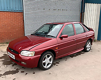 BNPS.co.uk (01202 558833)<br /> Pic: HampsonAuctions/BNPS<br /> <br /> Pictured: 1997 Ford Escort GTi.<br /> <br /> Since the 1990s, Geoff Barlow, 46, has collected dozens of classic cars from an Escort Mexico replica to several types of Transit, Cortina, and Sierra.<br /> <br /> However, he still regrets selling the first car which inspired his passion, a 1980 Escort Mark 2 he bought from his sister in 1992.  <br /> <br /> Geoff's fascination with Fords gathered pace in the last decade and he 'lost control,' buying as many Fords as he came across and saving them from disrepair.