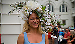 LOUISVILLE, KY - MAY 03: A woman wears a hat adorned with flowers to Thurby at Churchill Downs on May 3, 2018 in Louisville, Kentucky. (Photo by Scott Serio/Eclipse Sportswire/Getty Images)