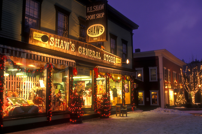 AJ5878, Stowe, general store, country store, village, ski resort, decorations, holiday, Christmas, evening, snow, winter, Vermont, Shops along Main Street are decorated for the Christmas holiday season in the village of Stowe at night in Lamoille County in the state of Vermont.