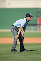 Umpire Reid Joyner handles the calls on the bases during the South Atlantic League game between the Hickory Crawdads and the Kannapolis Intimidators at CMC-Northeast Stadium on May 21, 2015 in Kannapolis, North Carolina.  The Intimidators defeated the Crawdads 2-0 in game one of a double-header.  (Brian Westerholt/Four Seam Images)