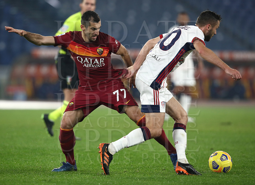 Football, Serie A: AS Roma - Cagliari calcio, Olympic stadium, Rome, December 23, 2020. <br /> Roma's Henrikh Mkhitaryan (l) in action with Cagliari's Sebastian Walukiewicz (r) during the Italian Serie A football match between Roma and Cagliari at Rome's Olympic stadium, on December 23, 2020.  <br /> UPDATE IMAGES PRESS/Isabella Bonotto