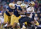 Nov. 2, 2013; Safety Eilar Hardy (16) hits Navy Midshipmen quarterback Keenan Reynolds (19) in the fourth quarter.<br /> <br /> Photo by Matt Cashore