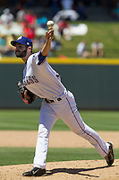 Round Rock pitcher Richard Bleier (30) delivers a pitch against the Nashville Sounds in the Pacific Coast League baseball game on May 5, 2013 at the Dell Diamond in Round Rock, Texas. Round Rock defeated Nashville 5-1. (Andrew Woolley/Four Seam Images).
