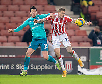 2nd January 2021; Bet365 Stadium, Stoke, Staffordshire, England; English Football League Championship Football, Stoke City versus Bournemouth; James McClean of Stoke City heads the ball in front of Adam Smith of Bournemouth