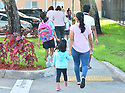 PEMBROKE PINES, FLORIDA - AUGUST 18: Student is seen drop off to school by they parents as faculty greet them arriving for the first day of classes at Pembroke Pines Charter Elementary a Broward County school in Pembroke Pines, Florida, U.S., on Wednesday, Aug. 18, 2021.  Florida State Board of Education said it would force defiant school districts to comply with Republican Governor Ron DeSantis executive order forbidding them from mandating students wear masks as a way to slow a surge in Covid-19 cases.  ( Photo by Johnny Louis / jlnphotography.com )