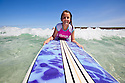Young girl on a surf board at beach. Eyre Peninsula. South Australia.