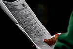 June 4, 2021: A fan peruses the  program during Friday racing at the Belmont Stakes Festival at Belmont Park in Elmont, New York. Scott Serio/Eclipse Sportswire/CSM