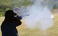 A contestant fires his muzzle-loading rifle on Sept. 24 2021 at the 66th annual Saunders Memorial Shoot in Berryville. Matches for rifle, pistol and shotgun shooters took place at the Luther Owens Park gun range in Berryville.<br />(NWA Democrat-Gazette/Flip Putthoff)
