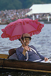 Henley Regatta. Spectator with pink parasol. Oxfordshire England.  The English Season published by Pavilon Books 1987. Page 139. <br /> <br /> Mrs Carrie M Davis, she was a regular and always carried this pink parasol during Henley week. Seen here sitting in a punt.
