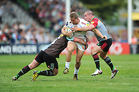 Sam Hill of Exeter Chiefs is tackled by Will Collier and Dave Ward of Harlequins during the Aviva Premiership match between Harlequins and Exeter Chiefs at The Twickenham Stoop on Saturday 7th May 2016 (Photo: Rob Munro/Stewart Communications)