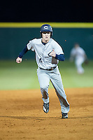 Jackson Raper (14) of the Catawba Indians hustles towards third base against the Belmont Abbey Crusaders at Abbey Yard on February 7, 2017 in Belmont, North Carolina.  The Crusaders defeated the Indians 12-9.  (Brian Westerholt/Four Seam Images)