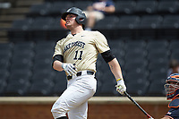 Shane Muntz (11) of the Wake Forest Demon Deacons follows through on his swing against the Virginia Cavaliers at David F. Couch Ballpark on May 19, 2018 in  Winston-Salem, North Carolina. The Demon Deacons defeated the Cavaliers 18-12. (Brian Westerholt/Four Seam Images)