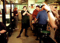 All the waitresses speak fluent American Sign language at the Rajin Cajun, a restaurant owned and operated by a deaf-blind man and frequented by deaf and deaf-blind clientele.  The owner, Danny Delcambre, opened the restaurant because no one would hire a deaf-blind man as a chef.  They wanted him to wash dishes instead.