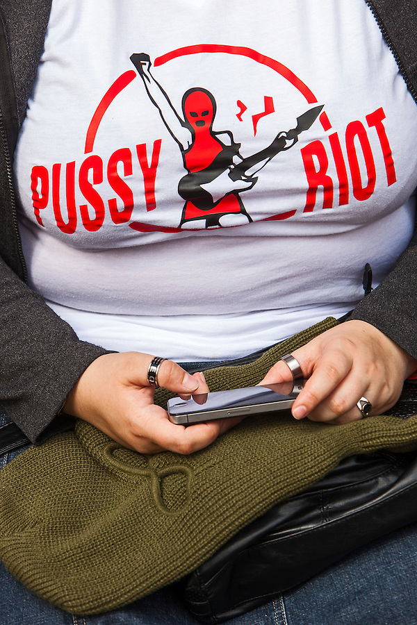 17/08/2012, Moscow, Russia..A protester tweets from outside the court as Maria Alyokhina, Yekaterina Samutsevich and Nadezhda Tolokonnikova of punk band Pussy Riot are sentenced to two years prison for their performance in the Christ The Saviour Cathedral.