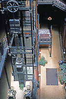 Los Angeles: Bradbury Building. Caged elevators and natural light flowing into courtyard center. Photo '78.